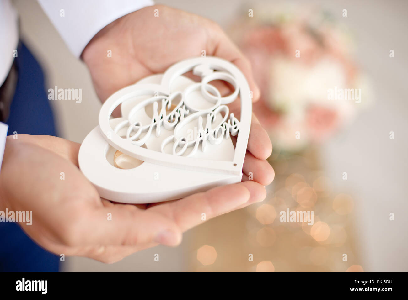 Close Up White Handmade Wedding Gift Box On Male Palms Against