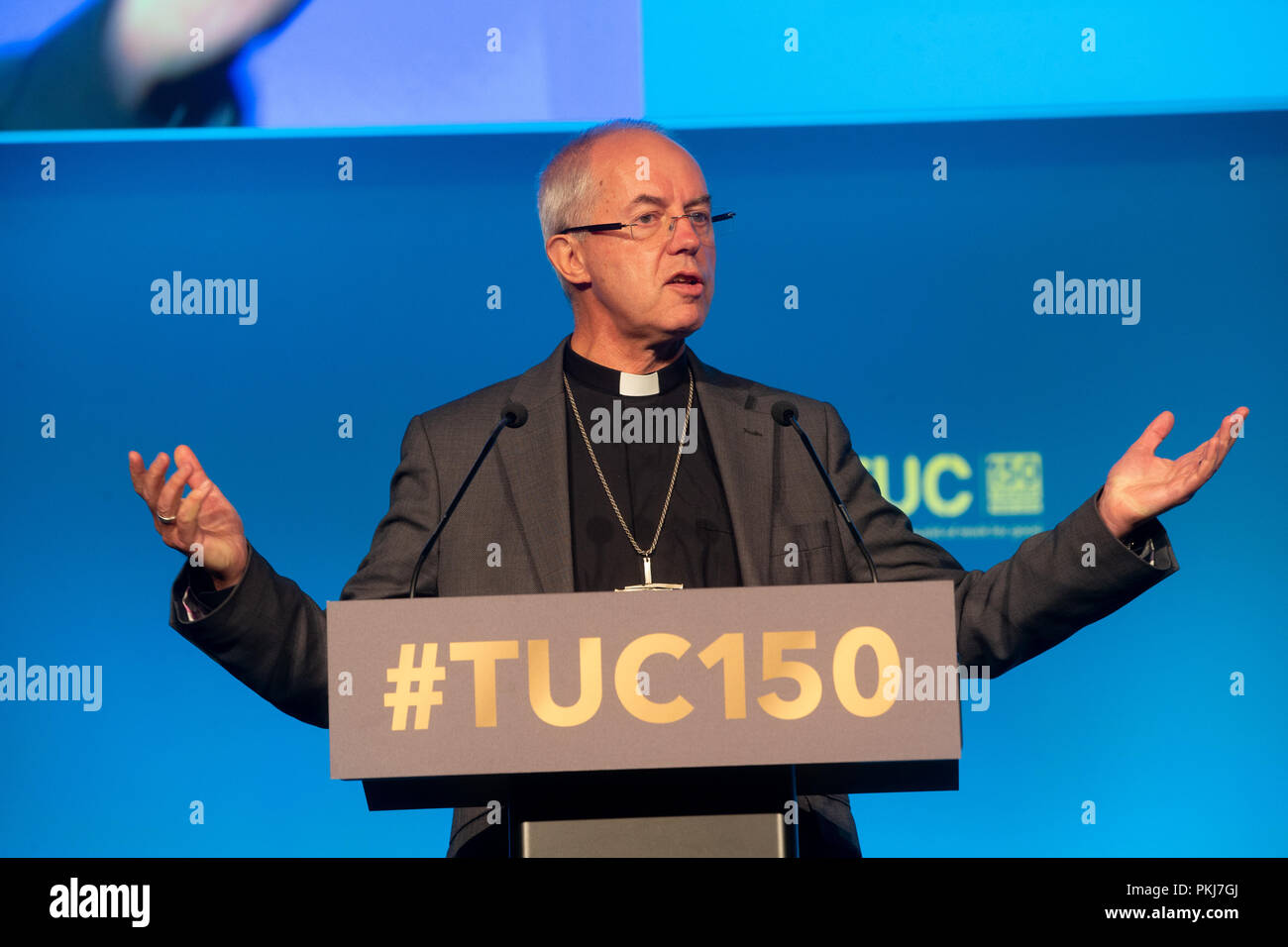 Archbishop of Canterbury, Justin Welby, speaking at the TUC conference. He criticised big companies like Amazon for dodging their fair share of tax. - Stock Image
