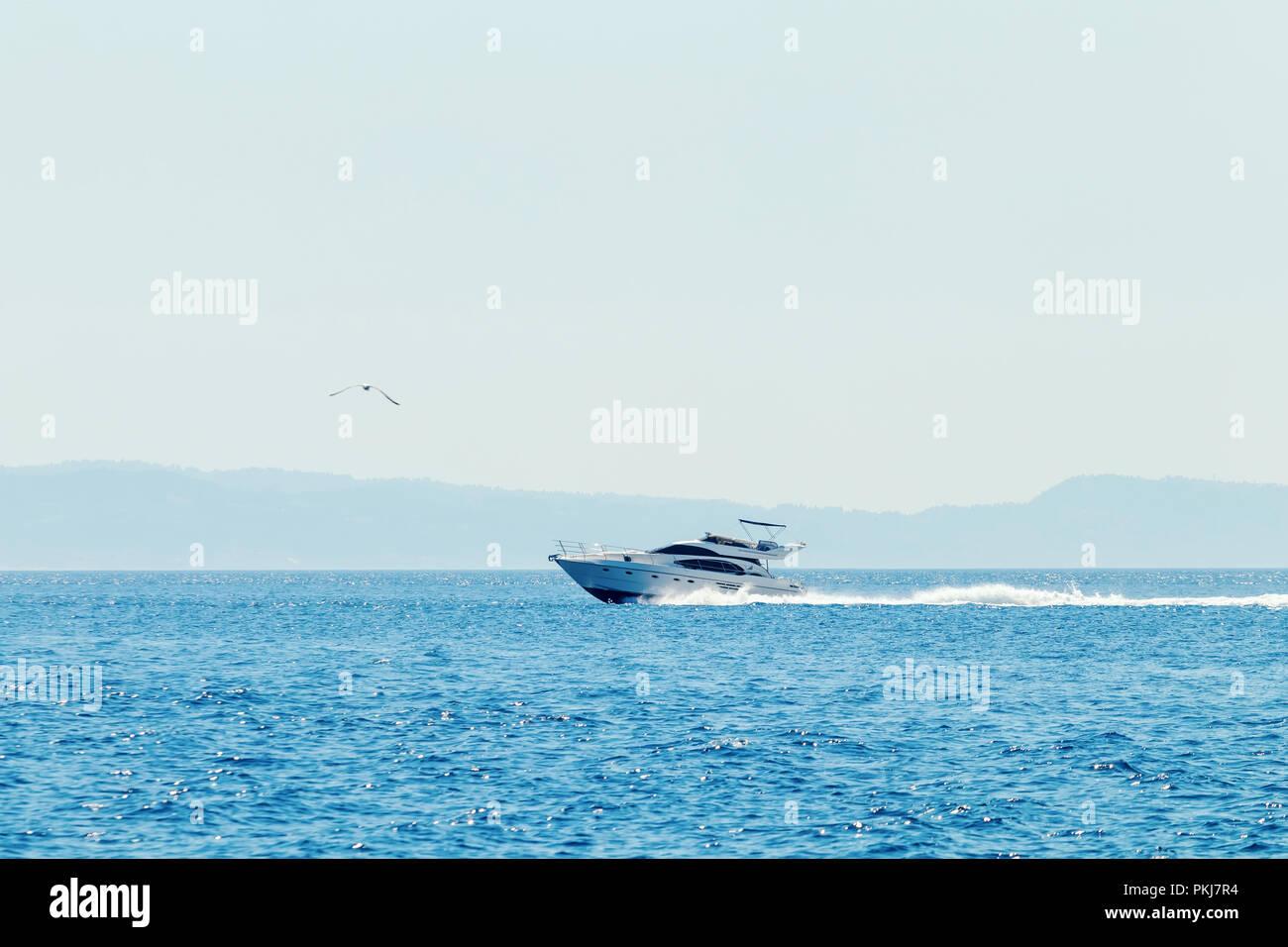 Luxury motor boat cruising in blue sea, Summer vacation - Stock Image
