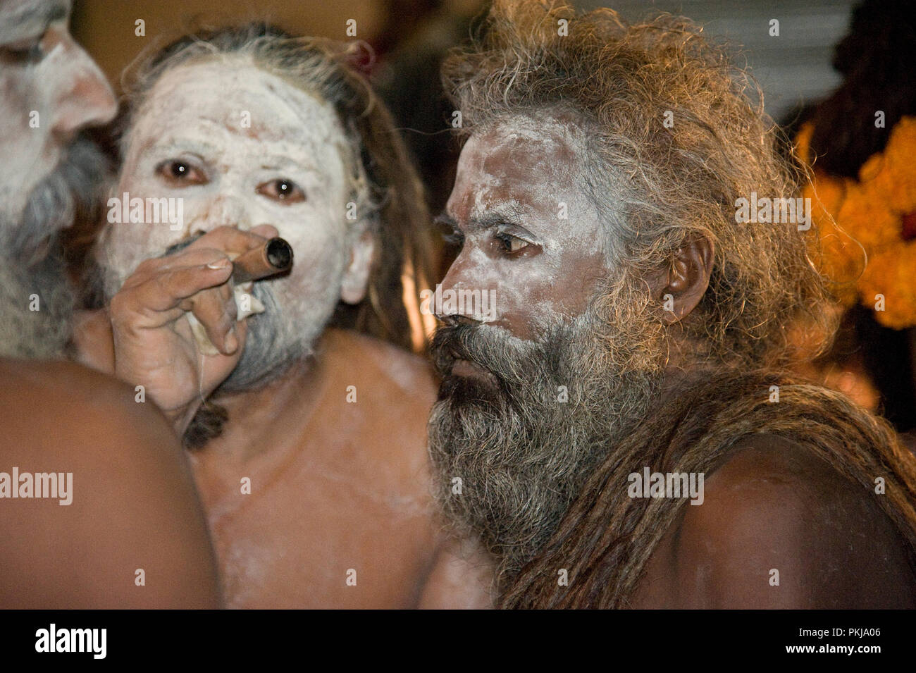 Naga Sadhu smoking a chillum at maharashtra India - Stock Image