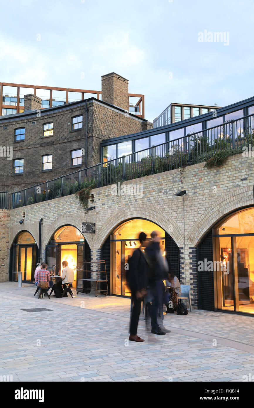 The stylish Tom Dixon showrooms on Bagley Walk, in historical converted brick archways in Coal Drops Yard at Kings Cross, in north London, UK - Stock Image