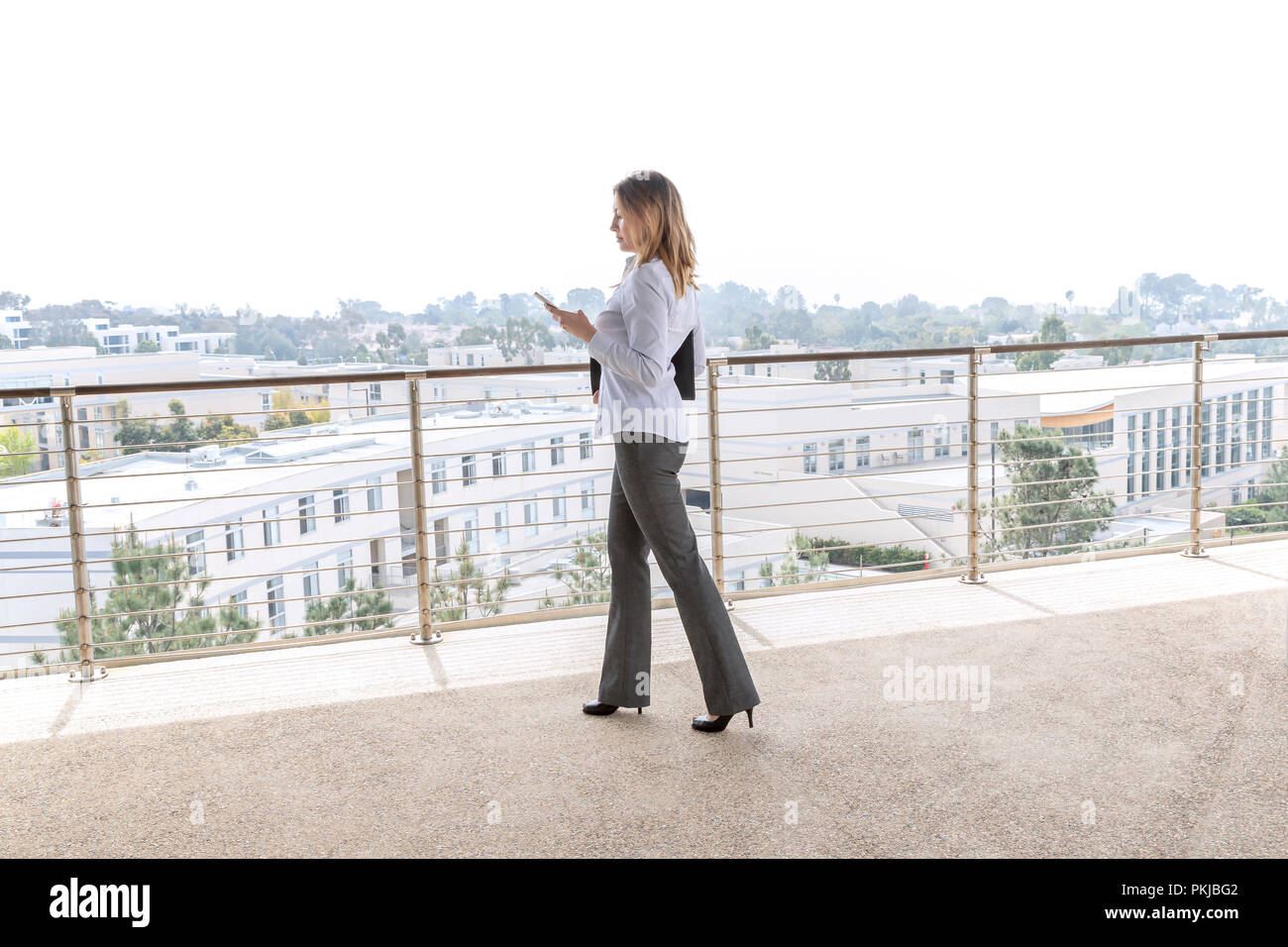 Female manager checking her schedule - Stock Image