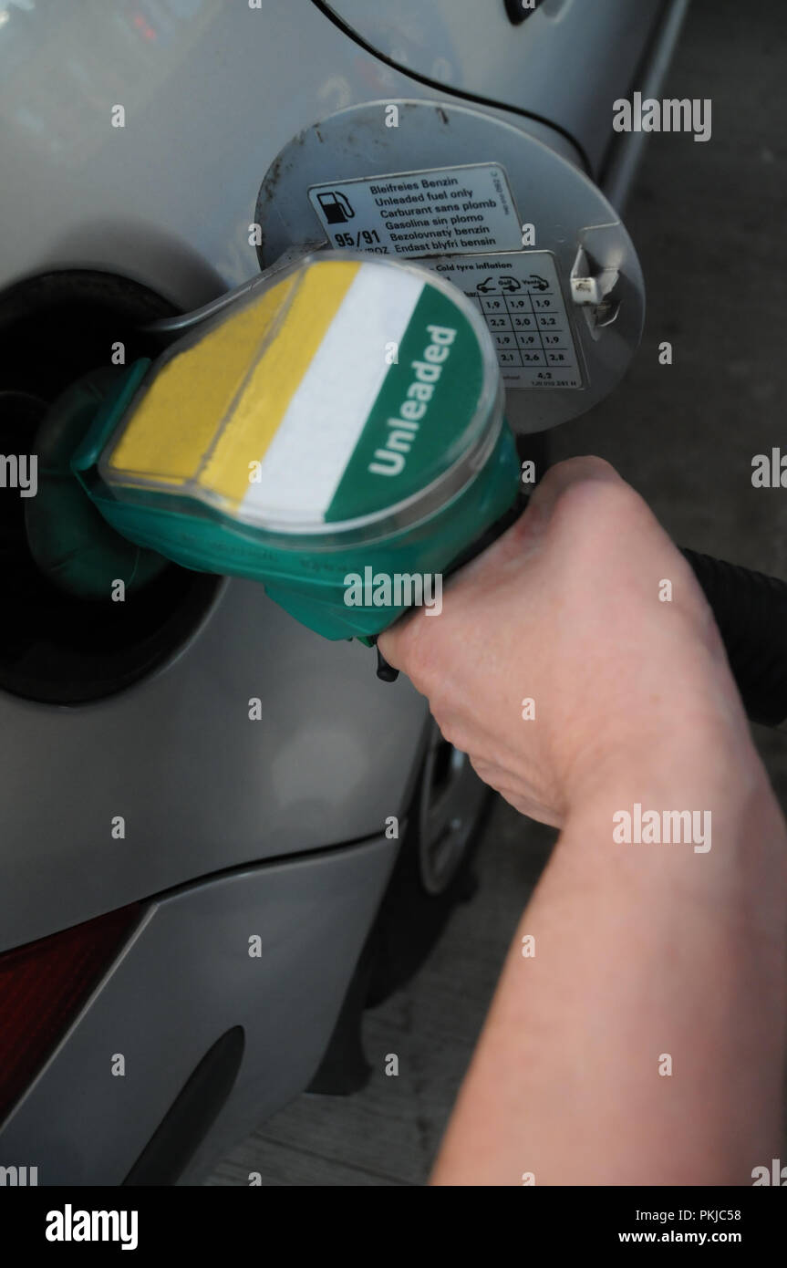 Filling up with unleaded petrol, London, UK. - Stock Image