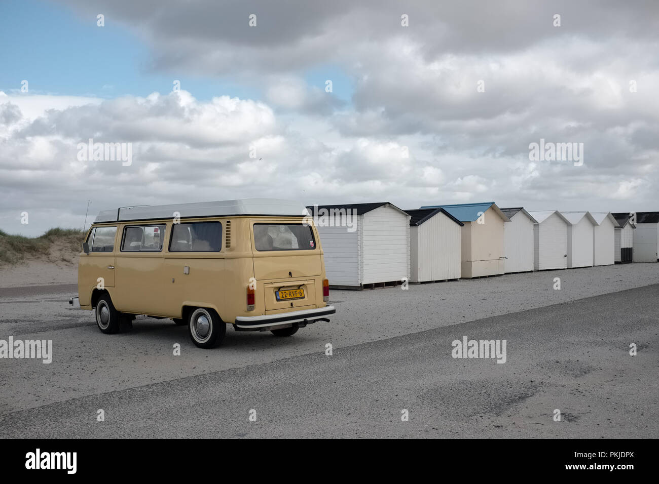Old Volkswagen van and beach cabins on a deserted beach, Saturday 14 May 2016, Texel, the Netherlands. Stock Photo