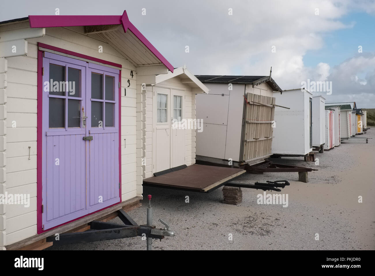 Beach houses lined up waiting for summer, Saturday 14 May 2016, Texel, the Netherlands. Stock Photo