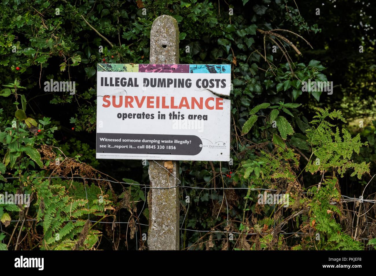 Illegal dumping warning sign in the Chiltern Hills, Buckinghamshire, England United Kingdom UK - Stock Image