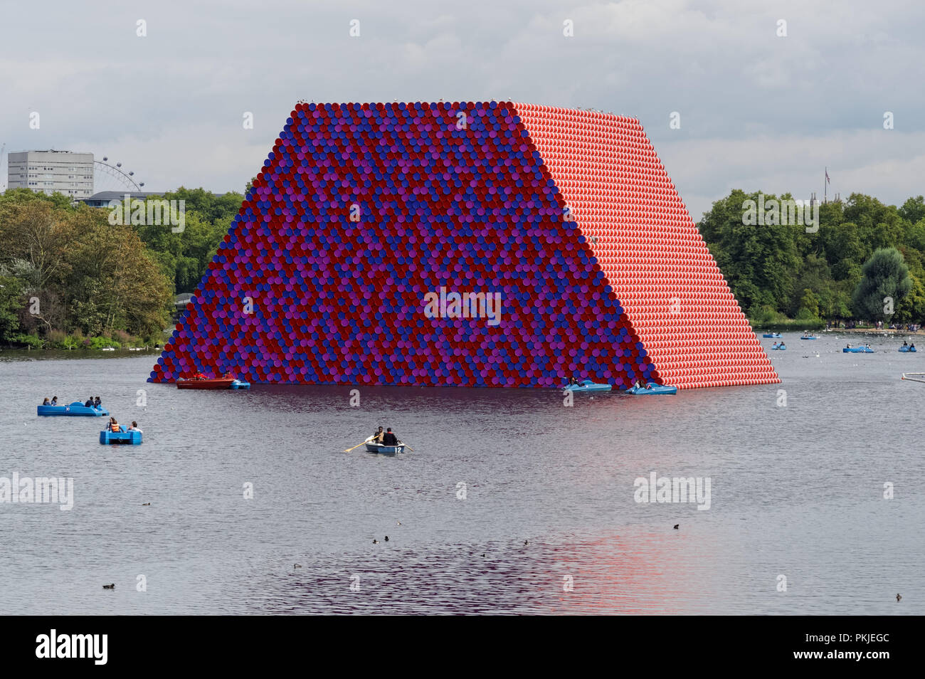 The London Mastaba, floating art installation by the artist Christo, on the Serpentine lake in Hyde Park in 2018, London England United Kingdom UK - Stock Image