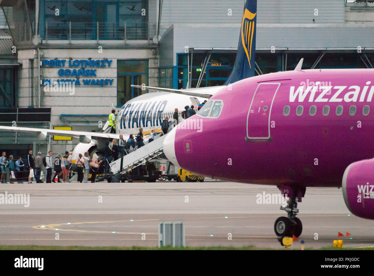 Low cost airline Ryanair aircraft Boeing 737-800 and low cost airline Wizz Air Airbus A320-200 in Gdansk Lech Walesa Airport in Gdansk, Poland. Septem - Stock Image