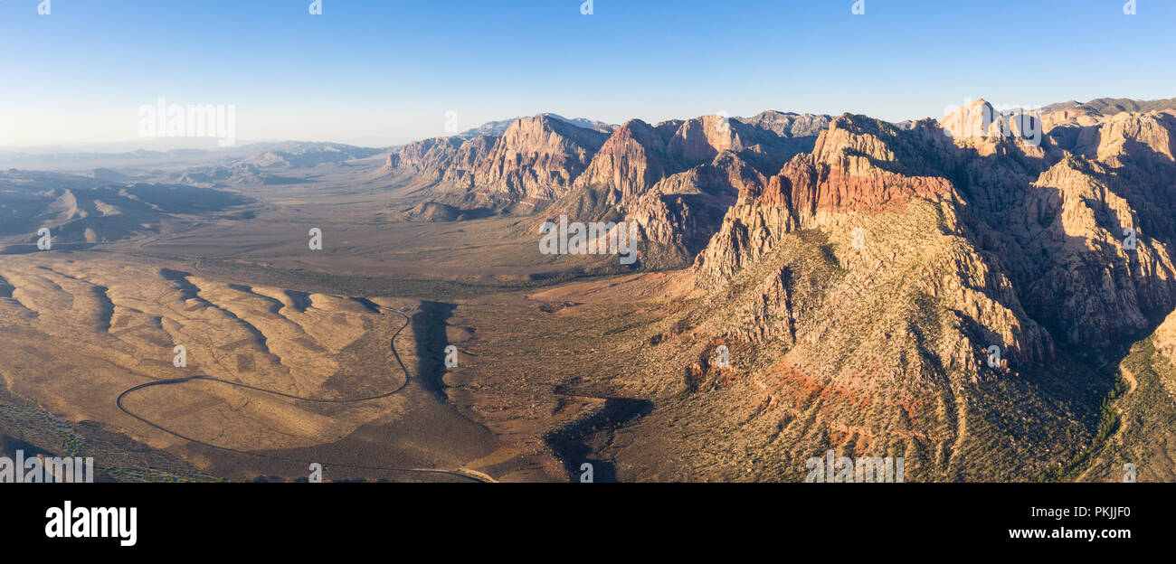 Early light shines on the massive geologic formations in Red Rock Canyon National Conservation Area, located just outside of Las Vegas, NV. - Stock Image