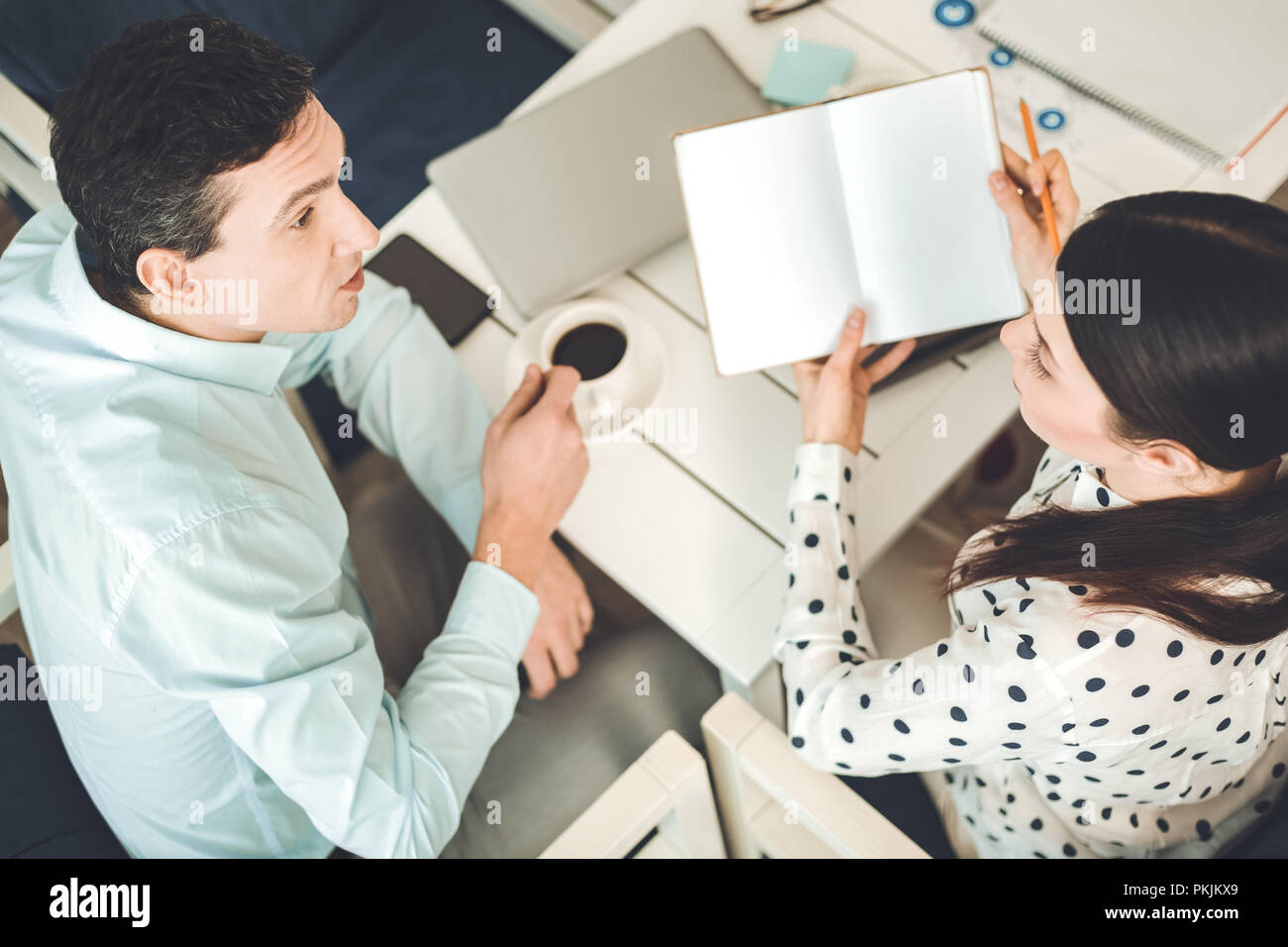 Top view of colleagues sitting at the table - Stock Image