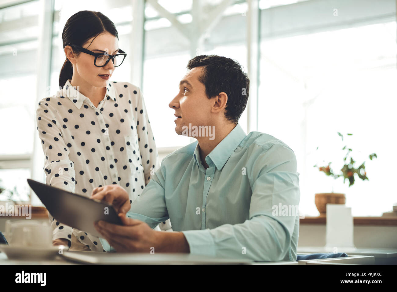 Nice smart man pointing at the tablet - Stock Image