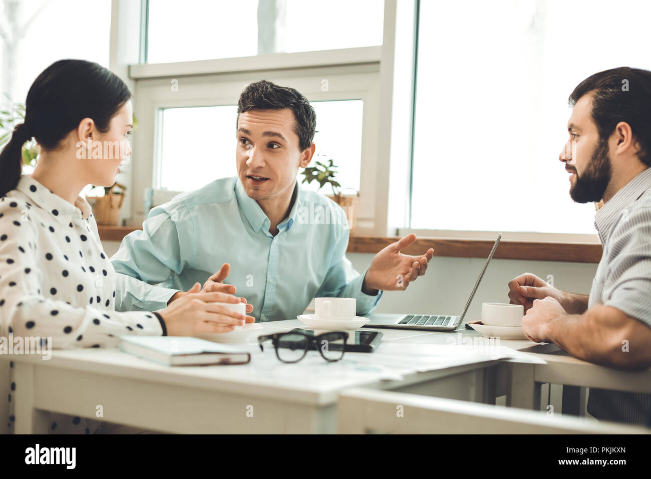 Nice smart people sitting at the table - Stock Image