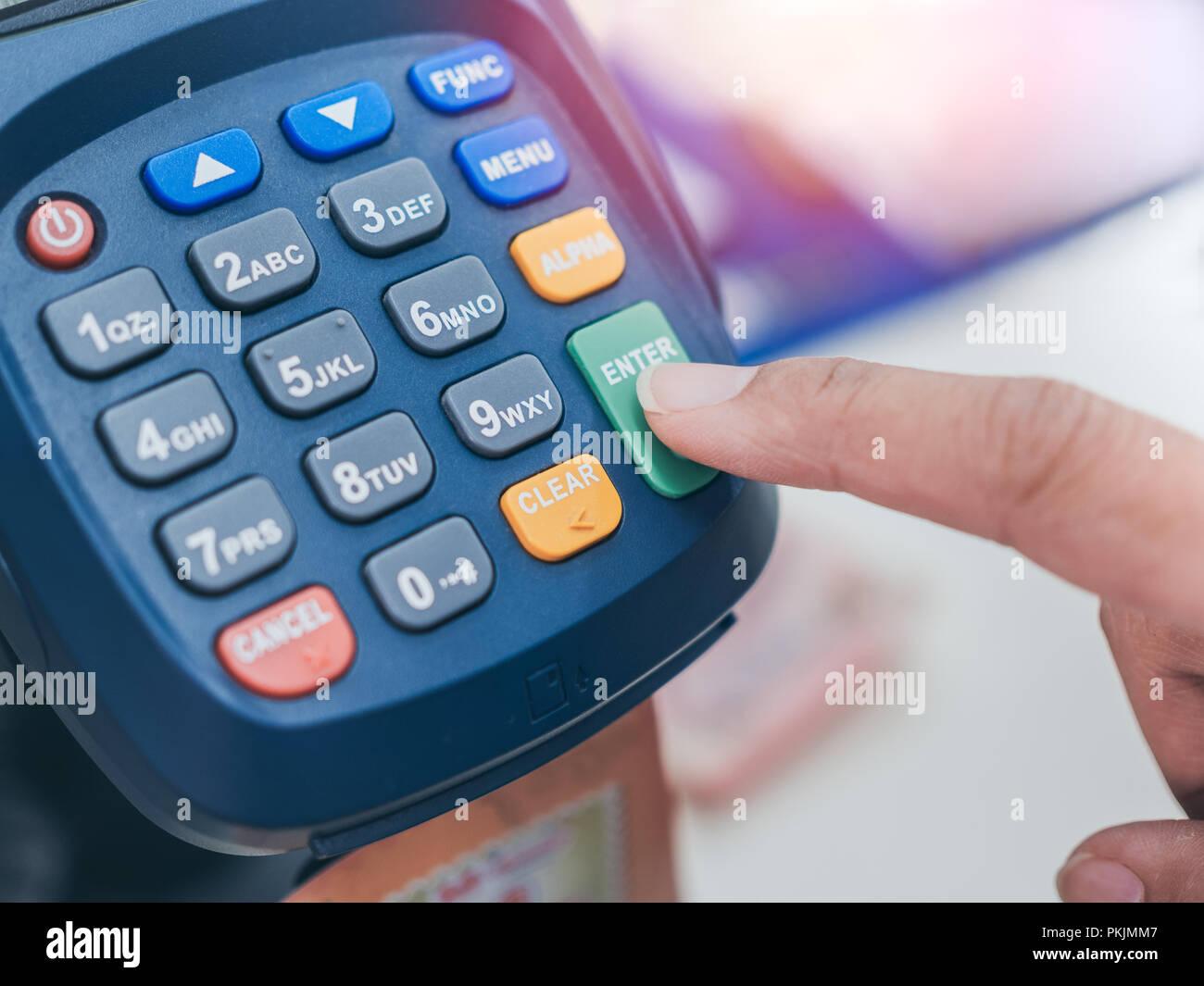 Close up finger push enter button for Credit or debit card