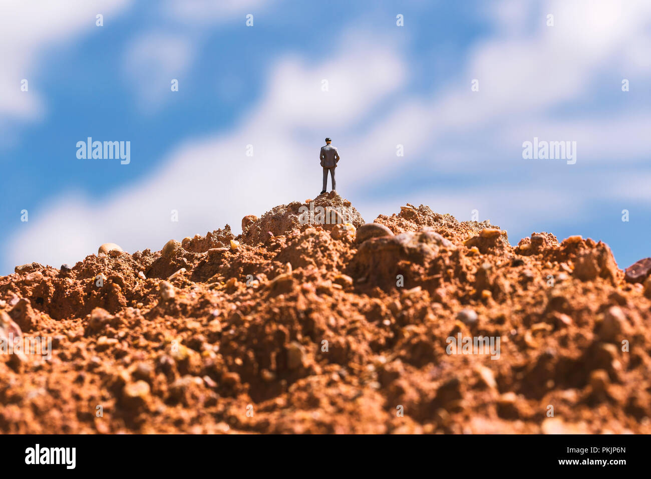 Conceptual of business man on the top hill, Simulate of successful in life. - Stock Image