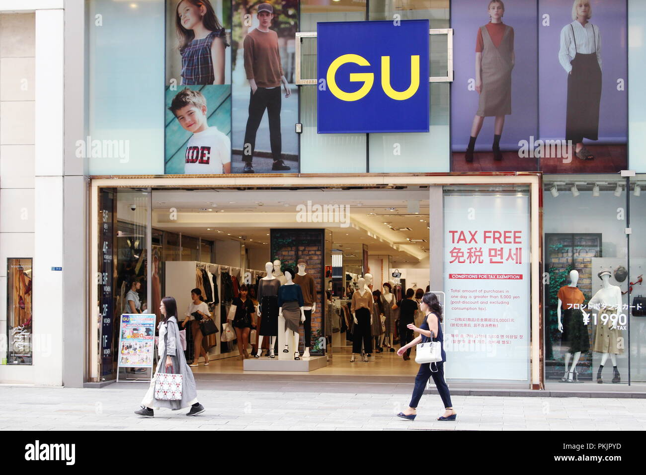 View of the front of a large GU clothes store in Ginza in central Tokyo. GU is owned by Fast Retailing which also owns Uniqlo. (9/2018) - Stock Image