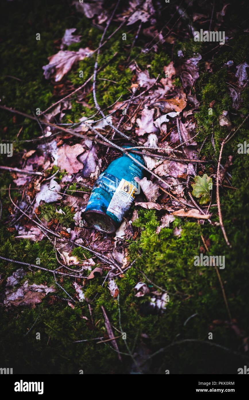 Dangerous rubbish left in Natural Woodland - Stock Image