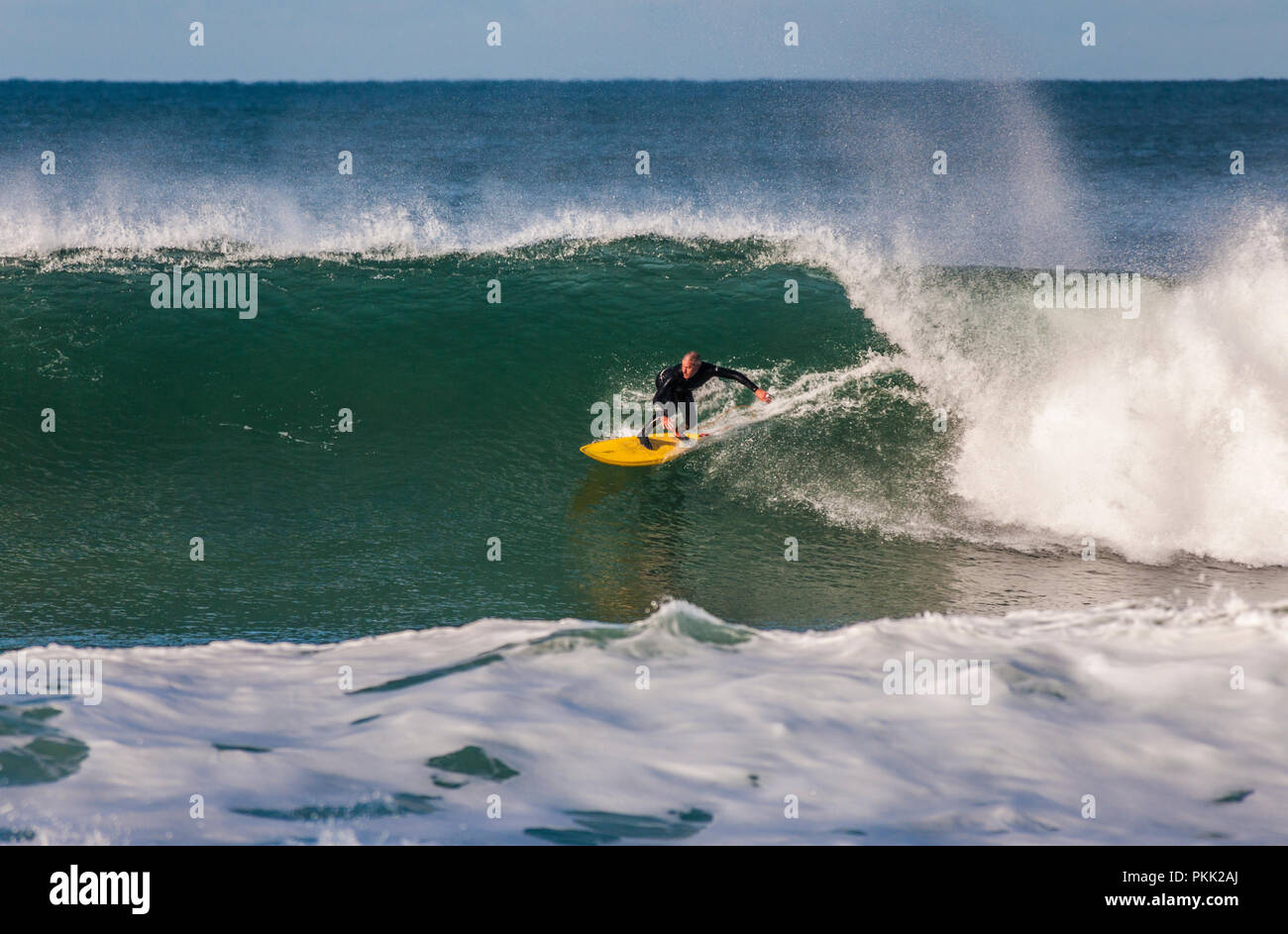 Surfer on a perfect right-hand wave, Bells Beach, Great Ocean Road, Victoria, Australia. - Stock Image
