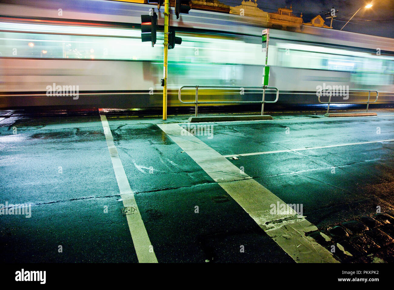 Tram passing down Lygon Street at night in Melbourne's inner northern suburb of Carlton. - Stock Image