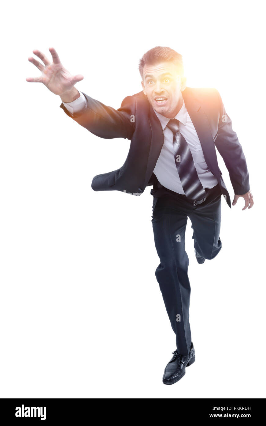 businessman runs forward stretching out his hand - Stock Image