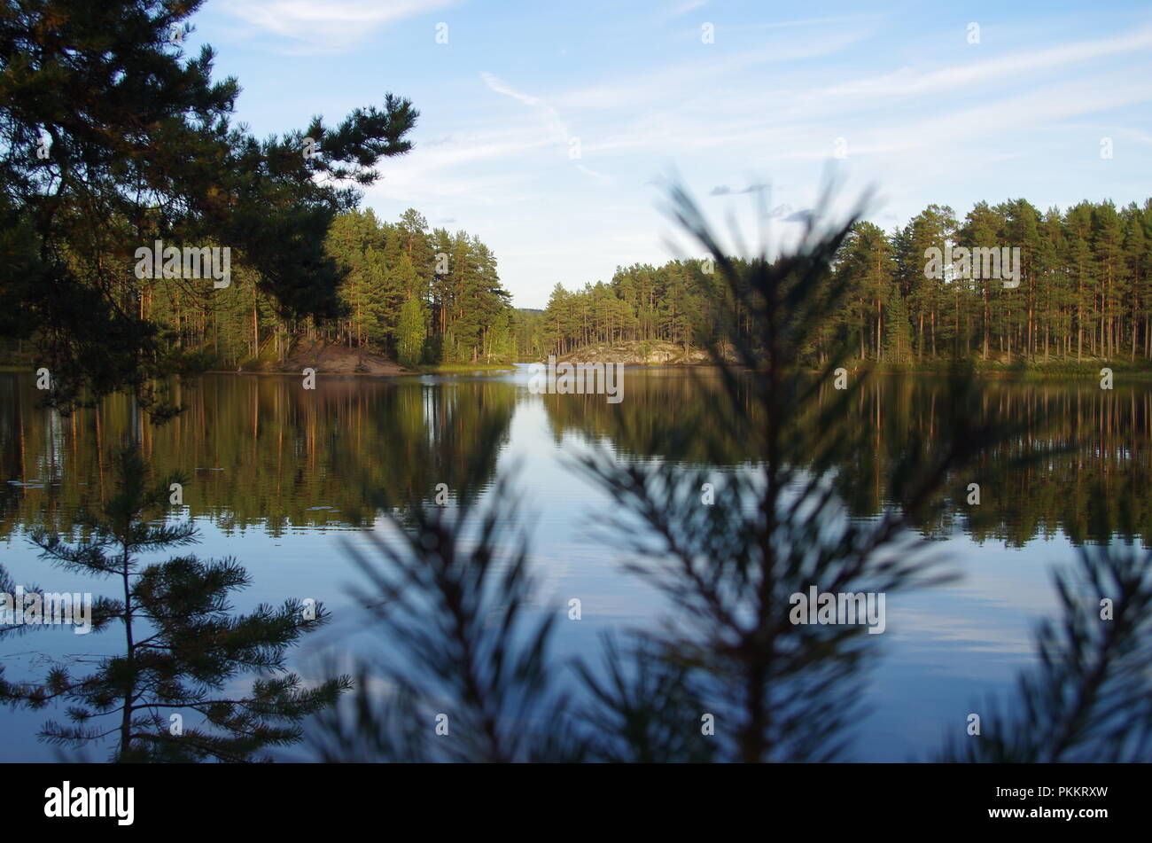 Beautiful lake scene on a sunny autumn afternoon in Sweden - Stock Image