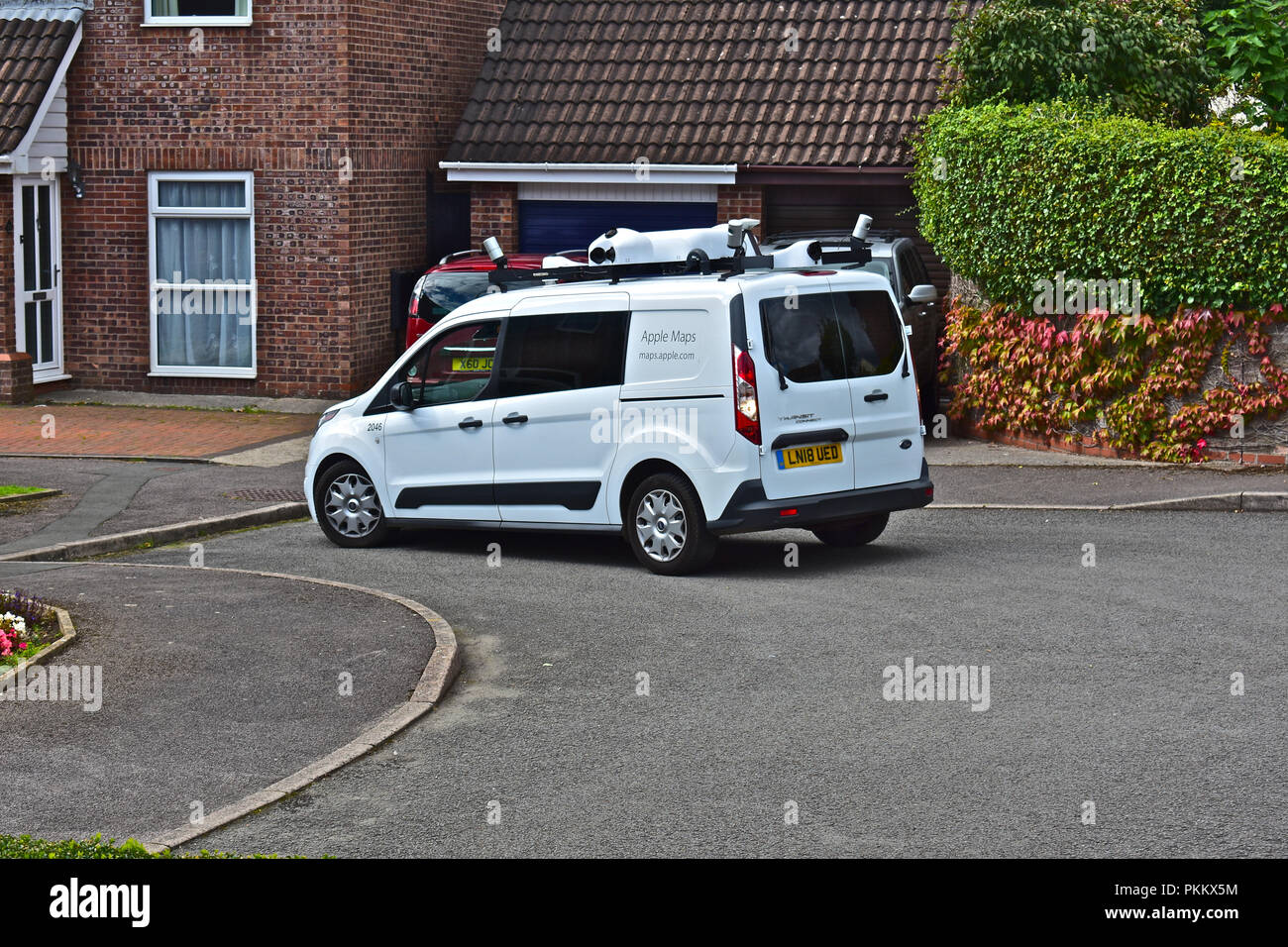 Apple Maps van seen in residential area of Bridgend S.Wales, gathering data to produce a rival to Google's Street View. Stock Photo