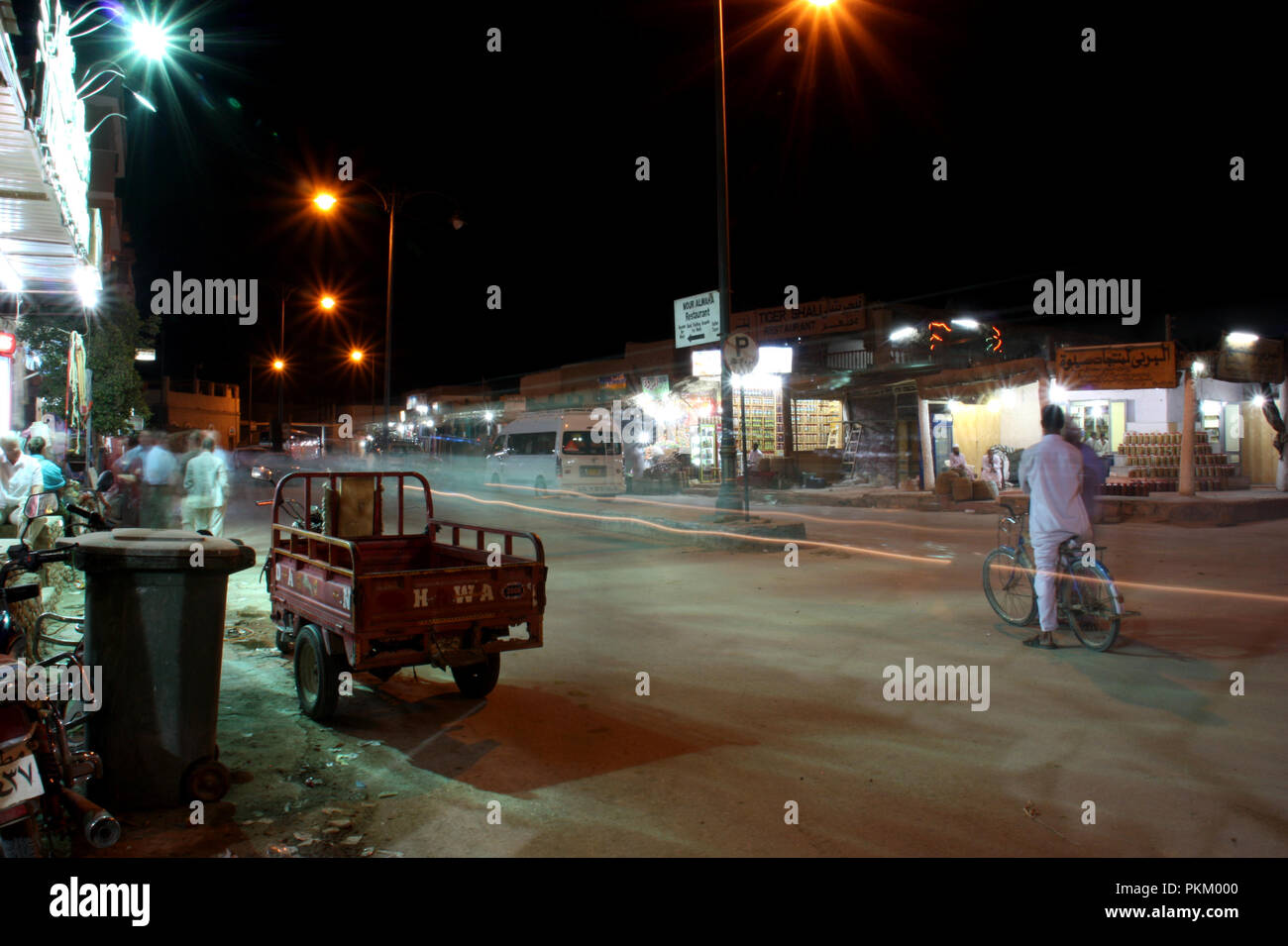 Men in front of a bar enjoying the night life in a street in Siwa, Siwa Oasis, Egypt - Stock Image