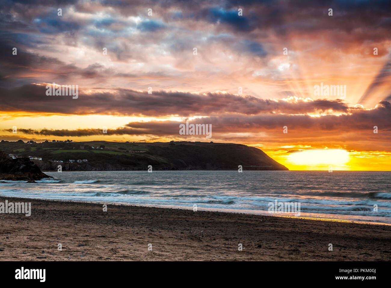 Sunset over Tresaith beach in Ceredigion, Wales, looking towards Aberporth. Stock Photo