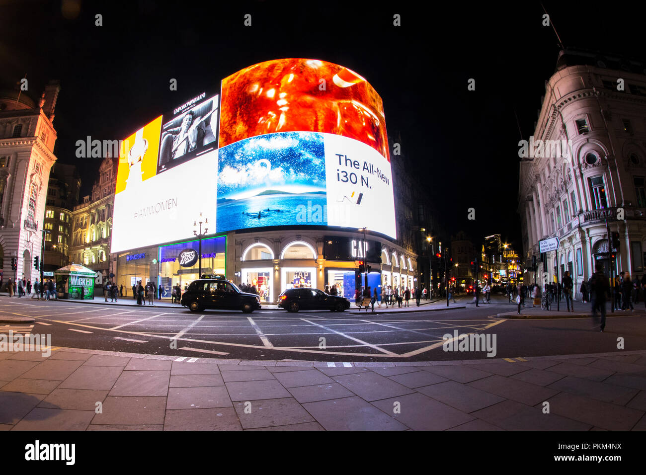 Picadilly Circus by Night in London - Stock Image