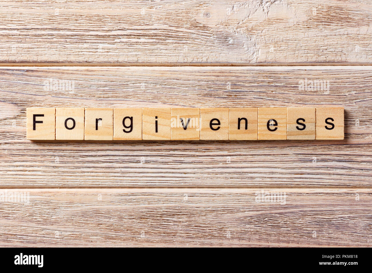 forgiveness word written on wood block. forgiveness text on table, concept. - Stock Image