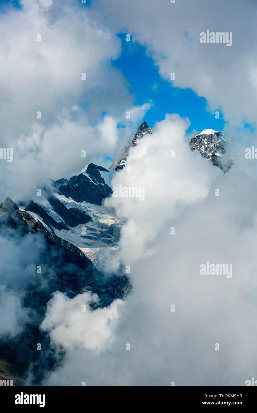 In the middleground Ober Gabelhorn peak (4.063 meters). On the right Wellenkuppe (3.903 meters). Zermatt. Swiss Alps . Valais. Switzerland. Europe. Stock Photo