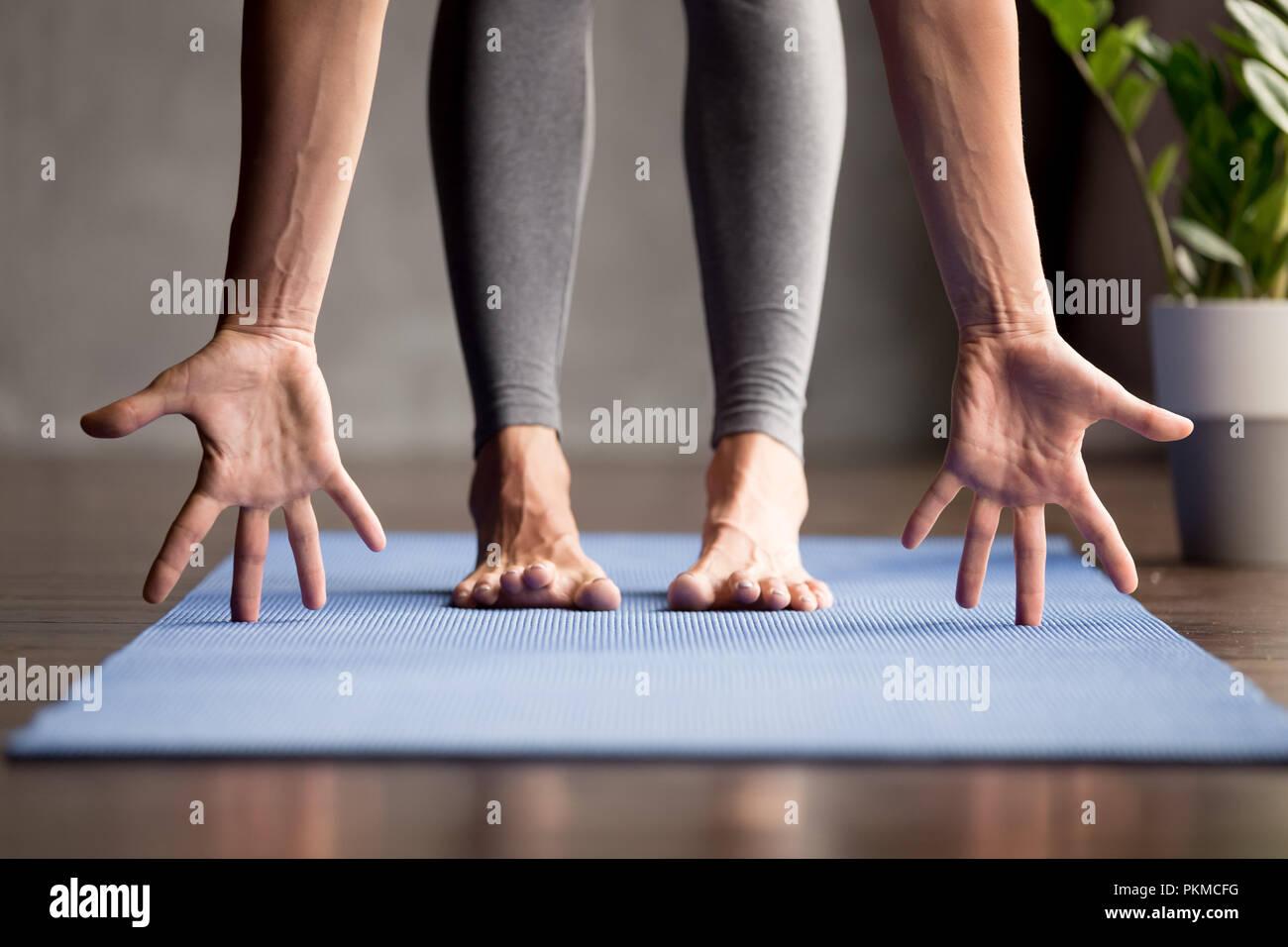 Sporty yogi woman practicing yoga, close up view - Stock Image