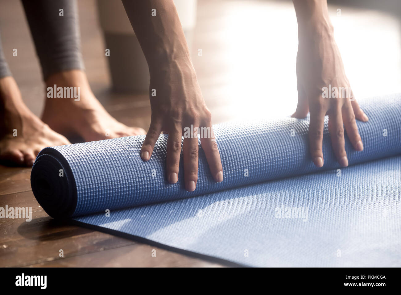 Blue fitness exercise mat, equipment for sport training session - Stock Image