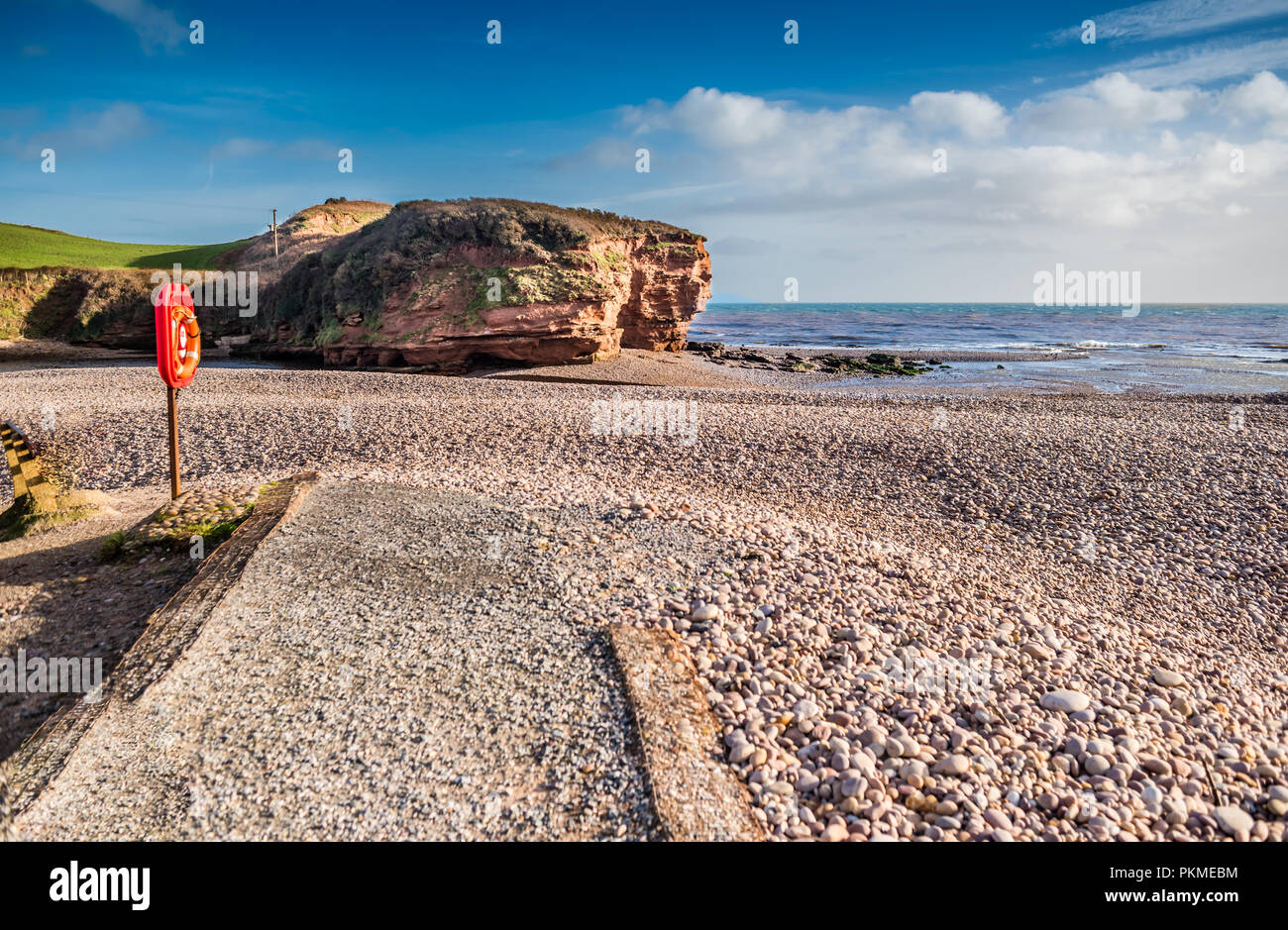 A glorious day just before Christmas on Budleigh Salterton beach. - Stock Image