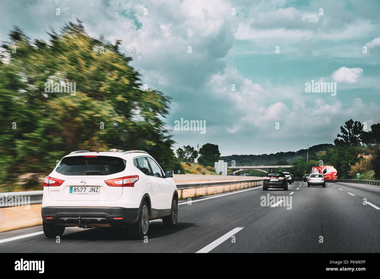 Vilalba Sasserra, Spain - May 18, 2018: Nissan Qashqai Driving In Motorway Road. The Nissan Qashqai is a compact crossover SUV produced by the Japanes - Stock Image