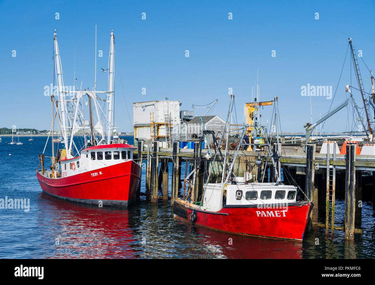 Commercial fishing boats docked at MacMillan Wharf, Provincetown, Cape Cod, Massachusetts, USA. - Stock Image
