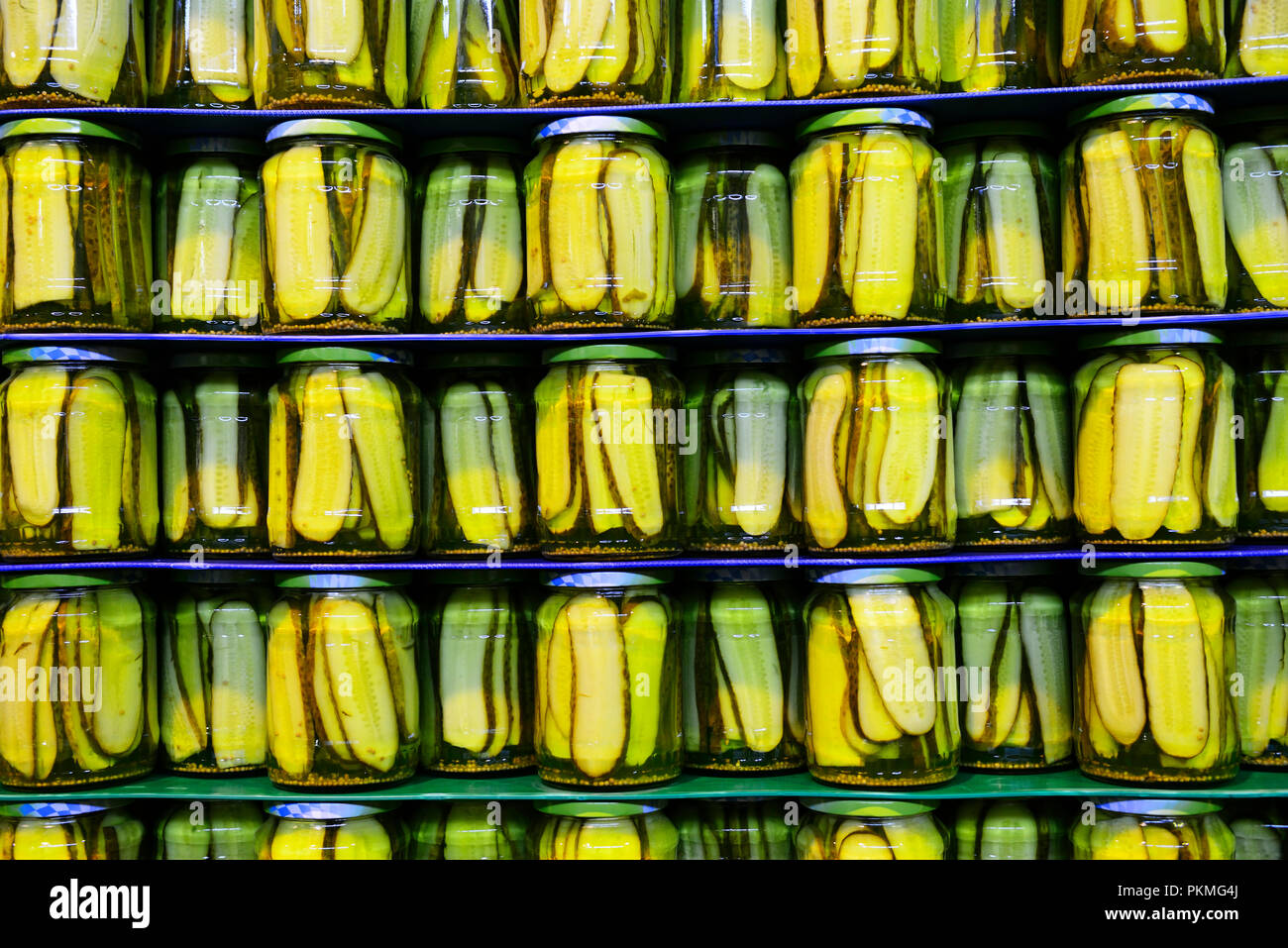 Pickled cucumbers in glass on pallet, Bavaria, Germany - Stock Image