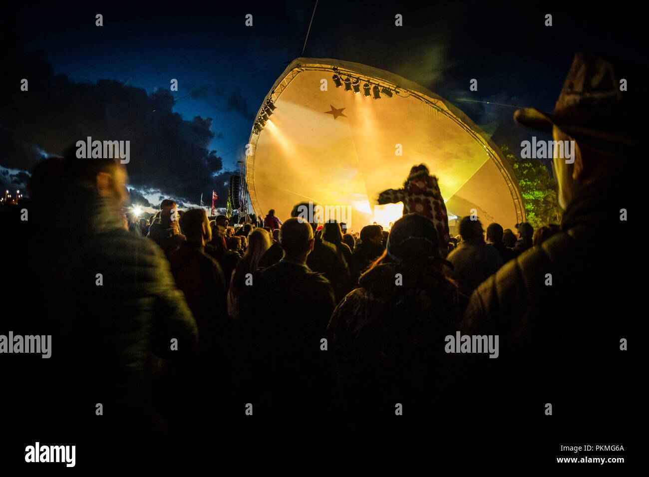 The audience enjoying the performers at the Big Tribute music festival, Wales's biggest event dedicated to tribute acts,  August Bank Holiday weekend,  Aberystwyth Wales UK Summer 2018 - Stock Image