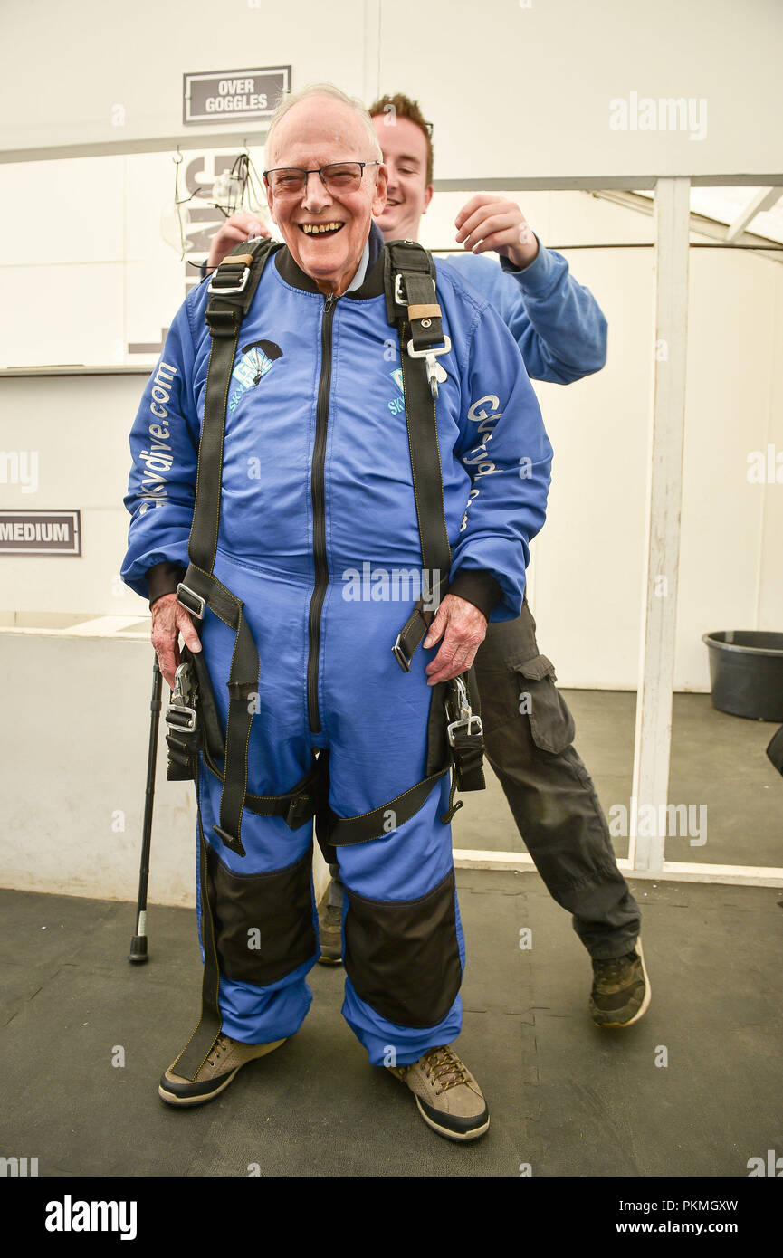 harry read 94 is helped into his skydiving harness at old sarum airfield salisbury wiltshire where he is taking part in his first high level skydive since he parachuted into normandy on 6 june 1944 PKMGXW harry read, 94, is helped into his skydiving harness at old sarum