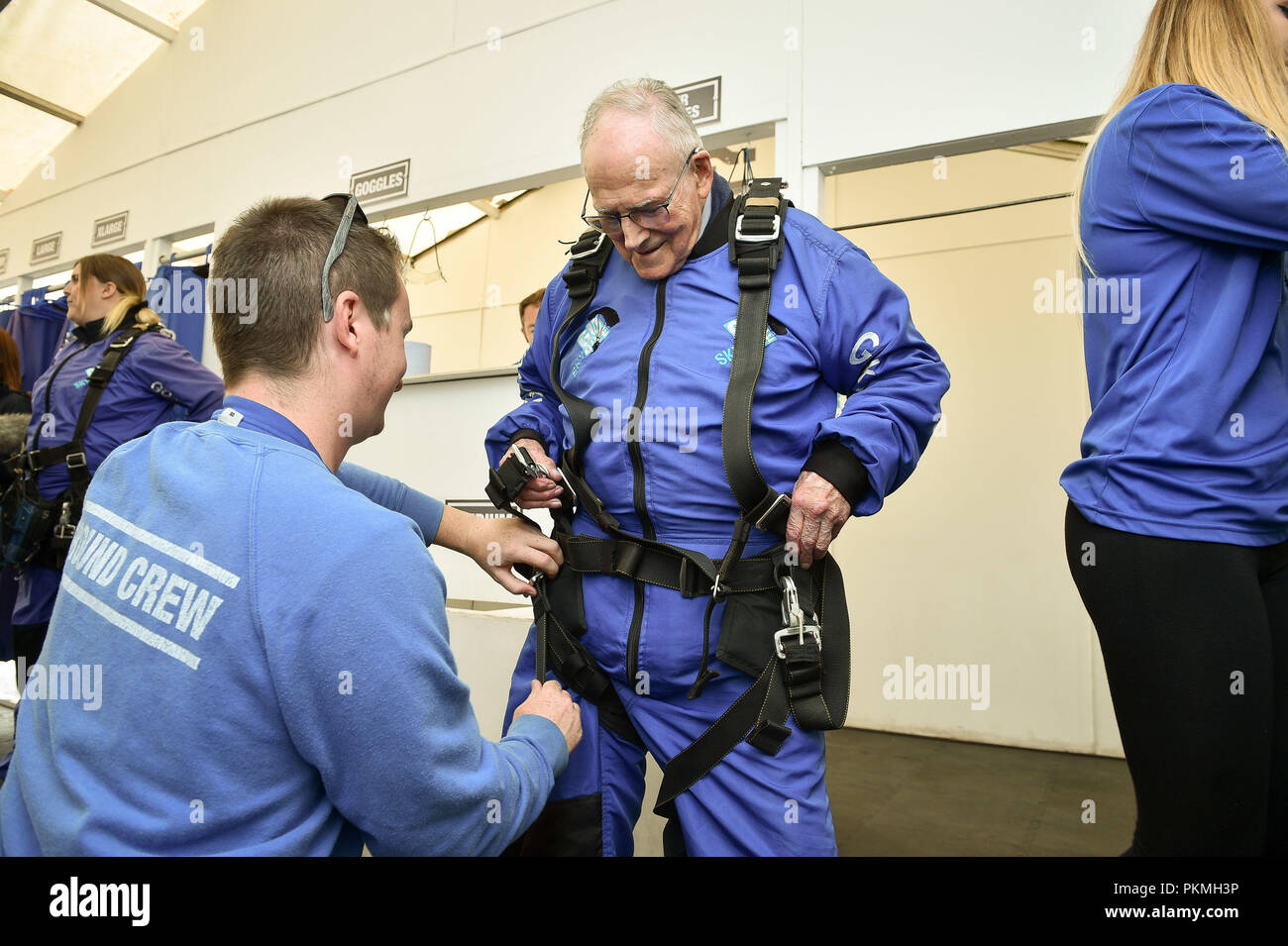 d day veteran harry read 94 is helped into his skydiving harness at old sarum airfield salisbury wiltshire where he is taking part in his first high level skydive since he parachuted into normandy on 6 june 1944 PKMH3P d day veteran harry read, 94, is helped into his skydiving harness