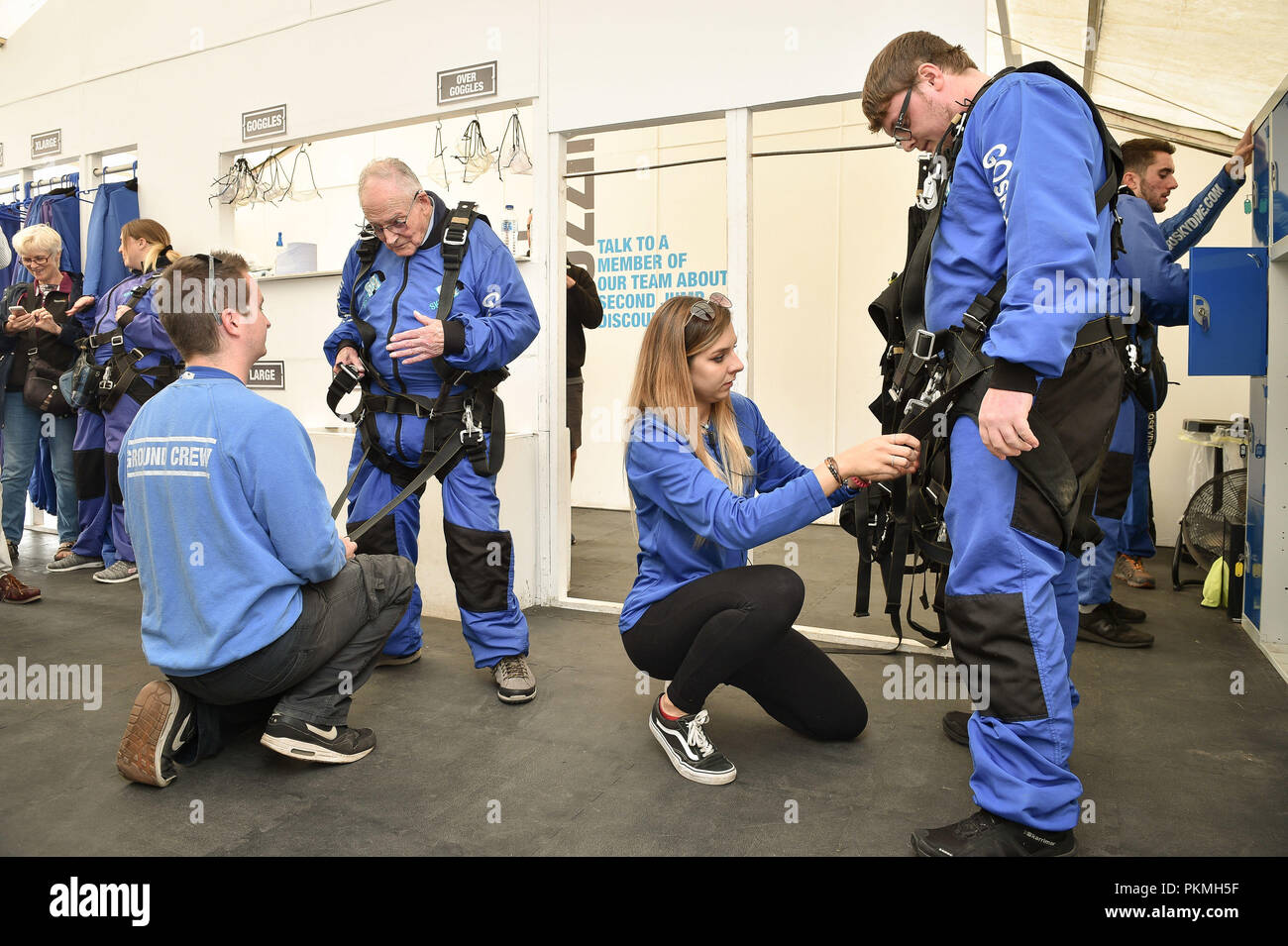 d day veteran harry read 94 is helped into his skydiving harness at old sarum airfield salisbury wiltshire where he is taking part in his first high level skydive since he parachuted into normandy on 6 june 1944 PKMH5F d day veteran harry read, 94, is helped into his skydiving harness