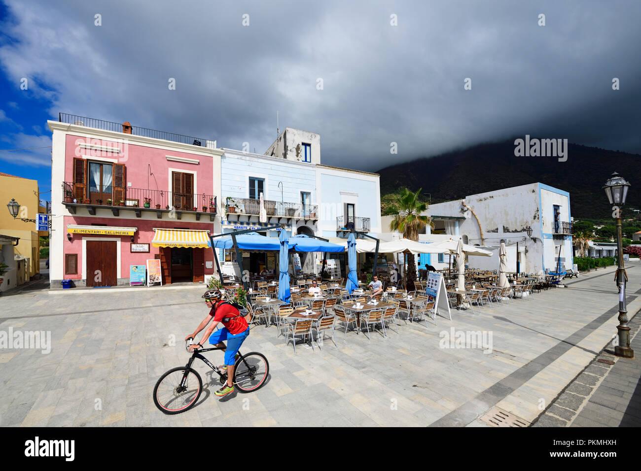 Cyclist in front of Ristorane da Alfredo in Lingua, Salina Island, Lipari or Aeolian Islands, Sicily, Italy - Stock Image