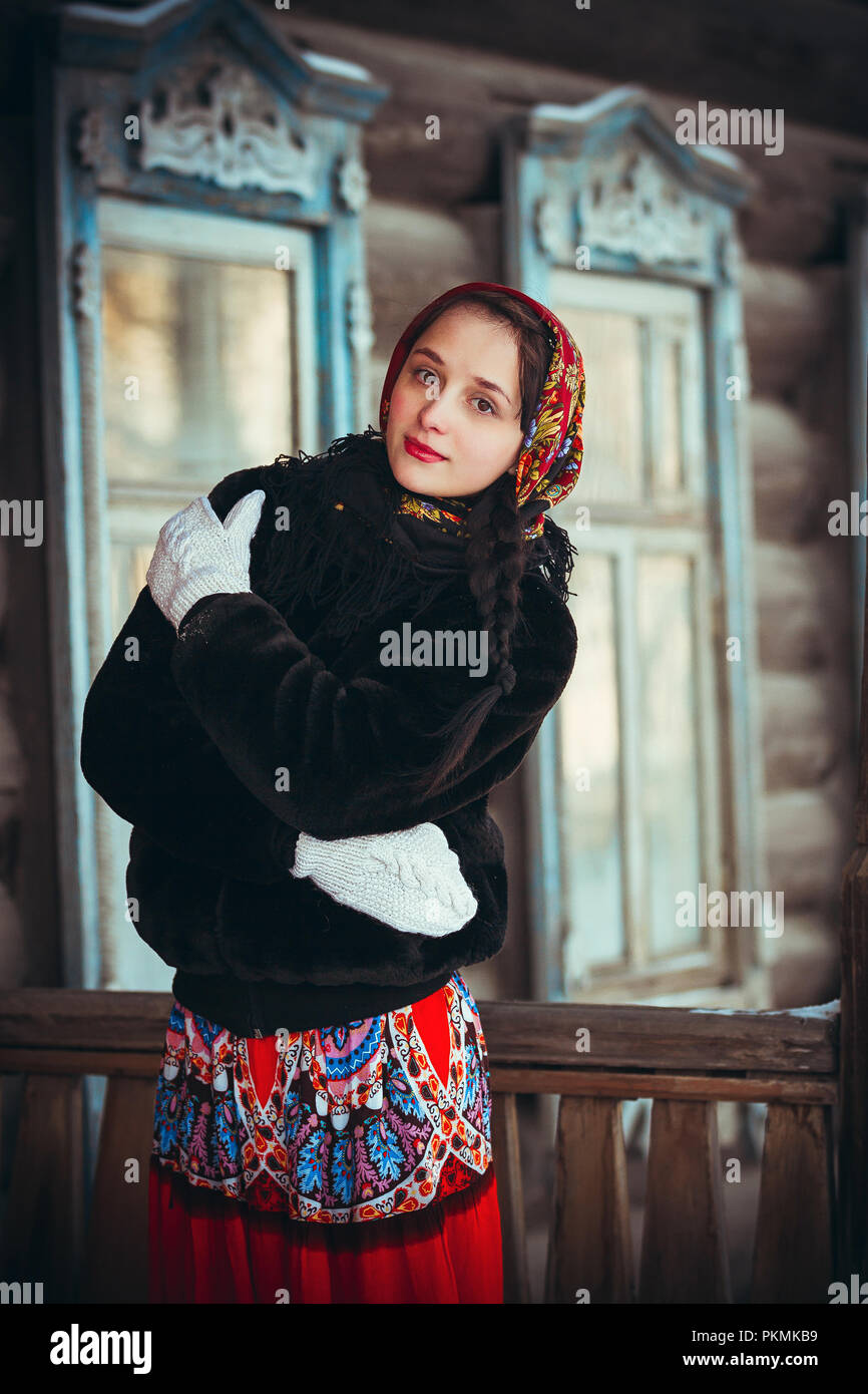 https://c8.alamy.com/comp/PKMKB9/russian-girl-in-the-winter-in-the-village-near-the-old-house-beautiful-woman-in-winter-scarf-on-head-PKMKB9.jpg