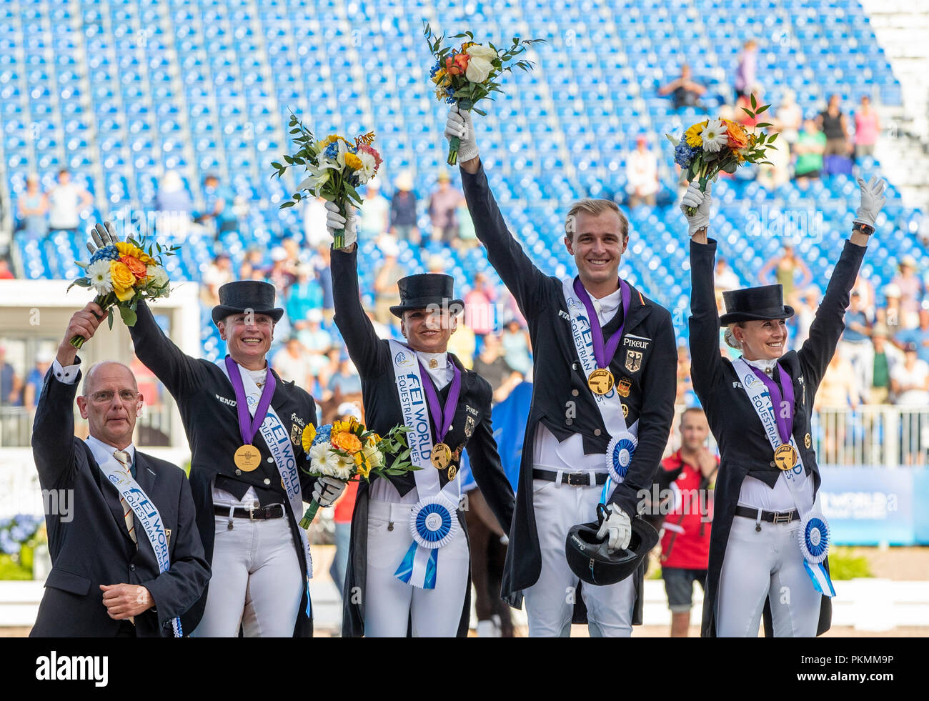 Tryon, USA. 13th Sep, 2018. Equestrian, FEI World Equestrian Game 2018, Grand Prix de Dressage: The dressage team from Germany, consisting of team head Klaus Roeser (left to right), Isabell Werth, Dorothee Schneider, Soenke Rothenberger and Jessica von Bredow-Werndl, standing on the podium and celebrating their victory. Credit: Stefan Lafrentz/dpa/Alamy Live News - Stock Image