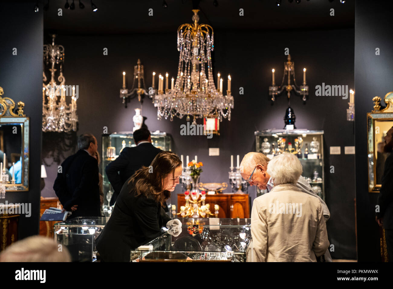 LONDON - SEPTEMBER 14: Visitors to the annual LAPADA Art and Antiques Fair which opened today, September 14, 2018,  in Berkeley Square, London. Over 100 exhibitors present work from across the art, antiques, design and decorative arts spectrum. The Fair runs from September 14-19, 2018. Photo by David Levenson/Alamy Live news - Stock Image