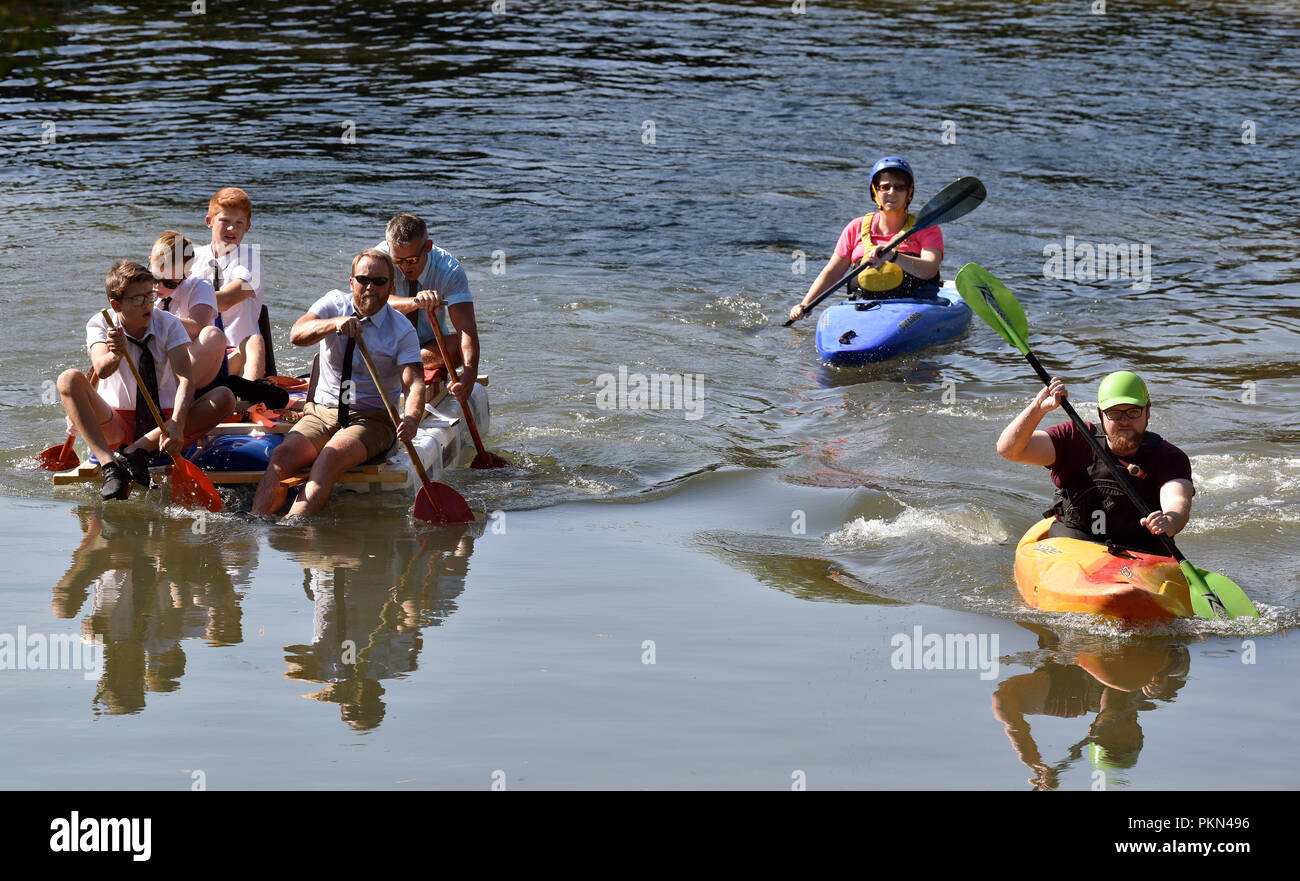 Raft race along Basingstoke Canal, Odiham, Hampshire, UK. 2 September 2018. - Stock Image