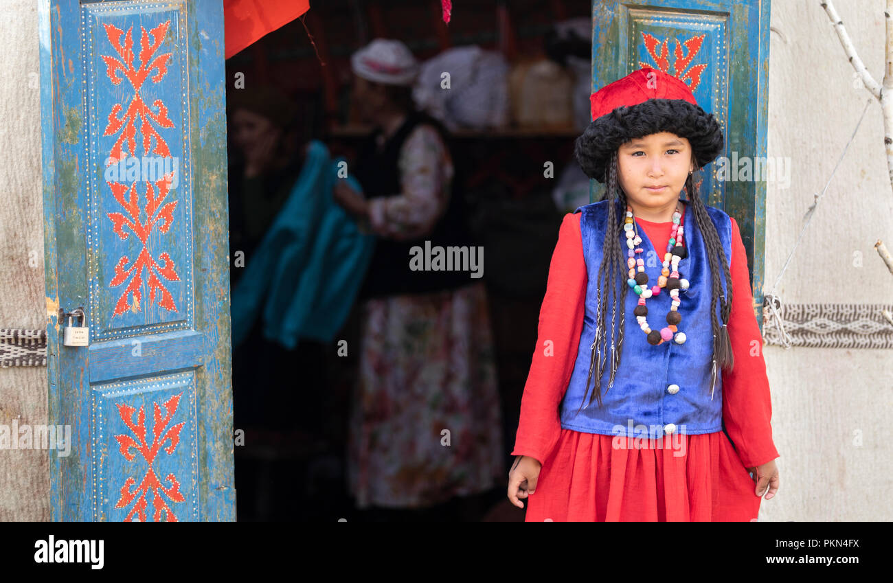 Lake Issyk-Kul, Kurgyzstan, 6th September 2018: local lady in full Kyrgyz outfit - Stock Image