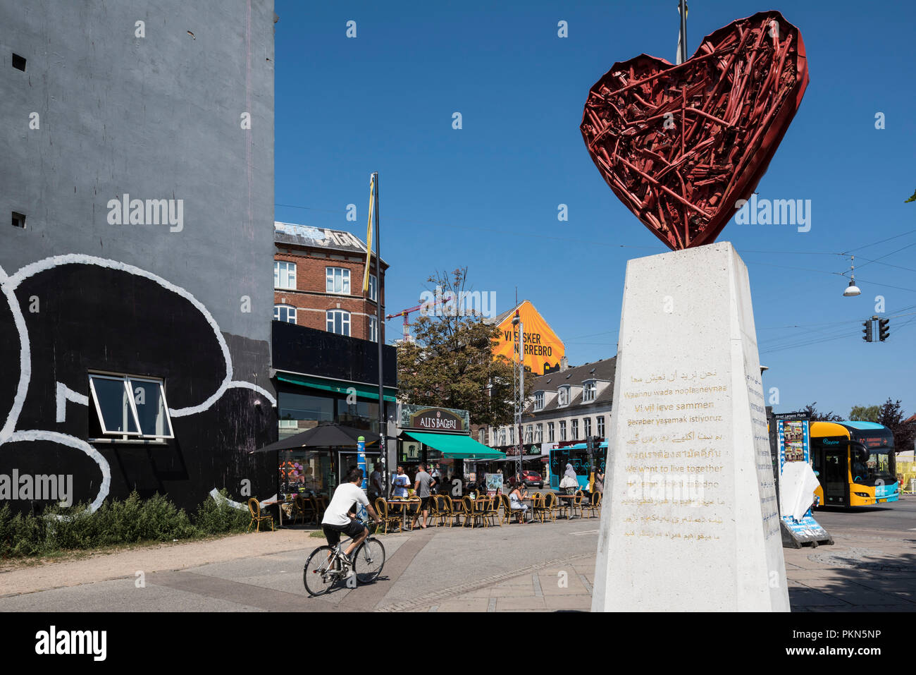 Copenhagen. Denmark. Nørrebro district, Nørrebrogade/Aksel Larsens Plads, with sculpture titled Farewell to the Weapons / Nørrebro's Heart, 2010, by a - Stock Image