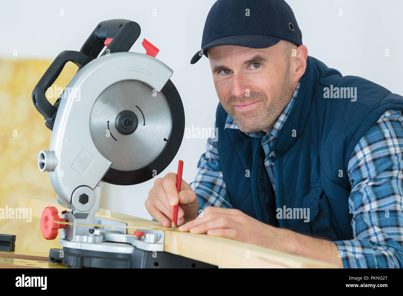 handsome carpenter looking at camera Stock Photo