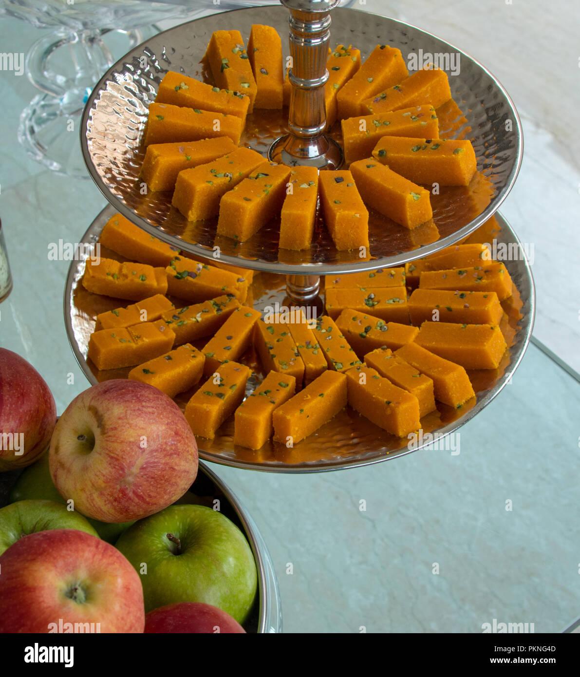 semolina dessert and apples on glass table - Stock Image