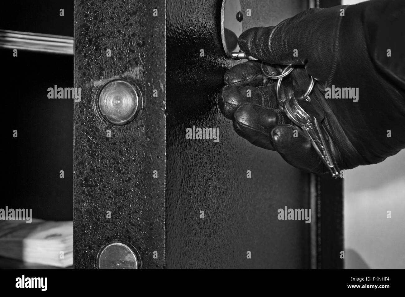 Detail of Open Safe with Hand of Thief - Stock Image